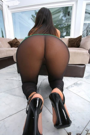 Hot babe in pantyhose Annika Adams posing and showing her ass and cunt
