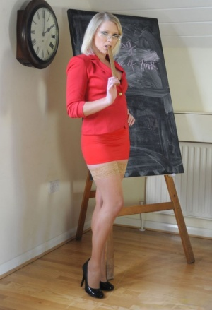 Alluring teacher Miss Abigail stripping and posing in nylon stockings