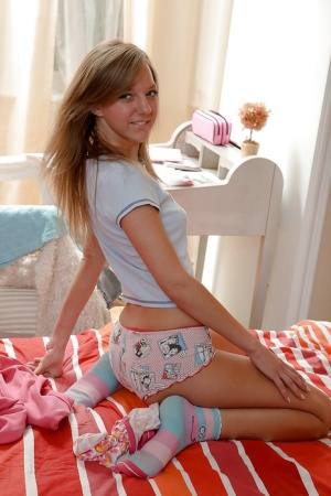 Foxy teen babe Elly taking off her panties and playing with her toys