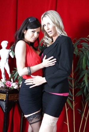 Veronica Avluv & Emma Starr touching and kissing each other