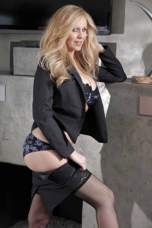 Curvy MILF in stockings Julia Ann stripping off her suit and lingerie