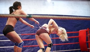 Sporty lesbians punching and grasping each other in the ring 11284703