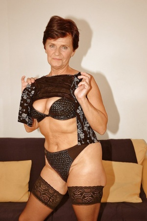 Short haired granny in stockings stripping off her dress and lingerie 18860781