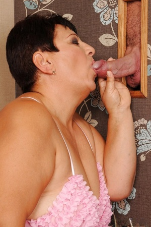 Fatty mature miss sucking cock through the gloryhole and gets banged