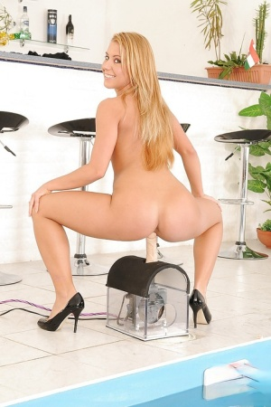 Lusty babe Nikky Thorne takes off her lingerie and rides a fucking machine