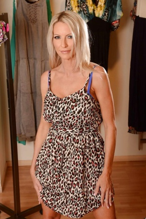 Seductive blonde MILF Emma Starr stripping off her dress and lingerie