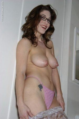 Busty amateur babe in glasses Katie Marie stripping and spreading her legs