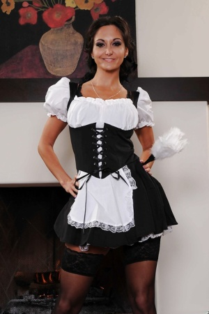 Busty babe Ava Addams stripping off her maid uniform and lingerie