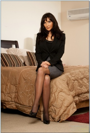 Seductive MILF in stockings Diana Prince stripping off her clothes