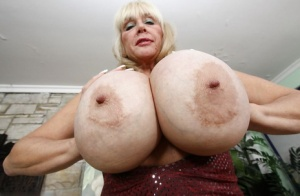 Filthy granny in shorts uncovering her jaw-dropping big round tits
