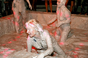 Fully clothed european fashionistas are into wild mud catfight