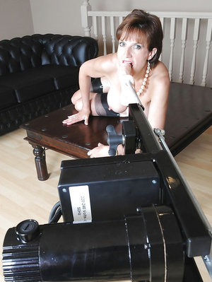 Hot mature lady exposing her big tits and playing with fucking machine