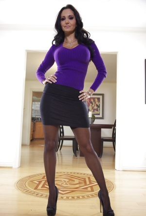 Ravishing vixen in stockings Ava Addams stripping off her clothes