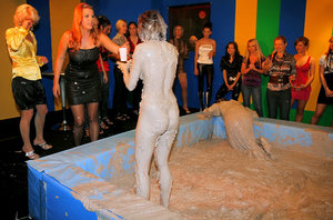 Seductive fetish gals with petite tits are into messy mud wrestling