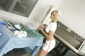 Pretty blonde with petite ass Jenny Hendrix posing in nurse uniform