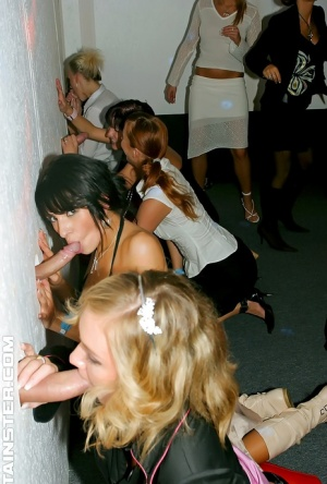Lustful gals showing off their cock sucking skills at the glory hole party