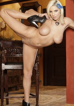 Big titted wife Lylith LaVey stripping and posing in flexible positions