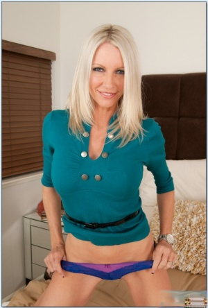 Blond MILF Emma Starr taking off panties to play with her cooter