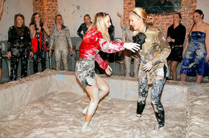 Kinky fully clothed european gals are into messy mud wrestling
