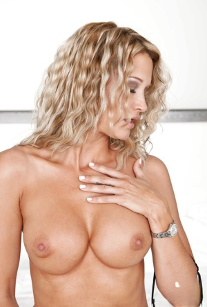 Seductive blonde MILF Jessica Drake slipping off her clothes