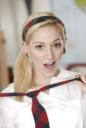 Naughty schoolgirl Rylie Richman stripping off her uniform and lingerie