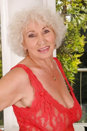 Naughty granny with massive flabby tits stripping off her sheer dress 63146961