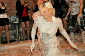 Kinky fetish ladies make some fully clothed mud wrestling action