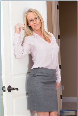 Sexy teacher in stockings Simone Sonay slipping off her suit and lingerie