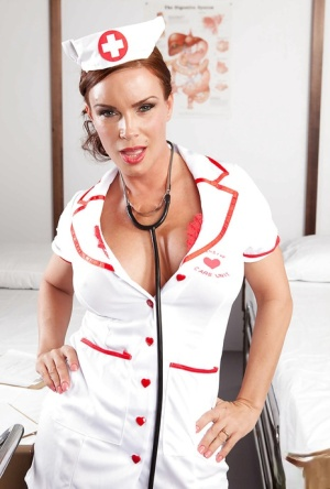 Curvy MILF Diamond Foxxx taking off her nurse uniform and teasing her cunt