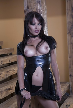 Raven-haired MILF in latex outfit revealing her big round boobs