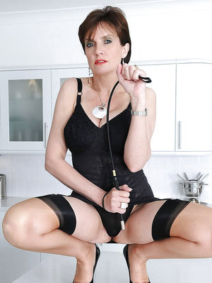 Fuckable mature femdom posing in black lingerie and stockings
