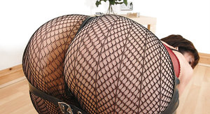 Lusty mature fetish lady with sexy ass posing in snazzy skirt and pantyhose