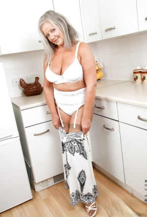 Naughty granny with chubby curves undressing and playing with herself 38307927