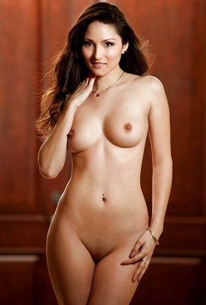 Amazingly lovely brunette centerfold posing nude and taking bath