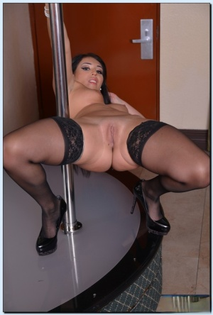 Fascinating amateur in stockings Parker Page performs a steamy striptease