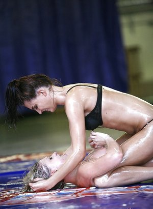 Lecherous lesbians have an oily catfight turning into pussy licking action