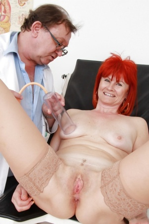 Redhead mature gal in stockings gets examed by a perverted gyno 46400713