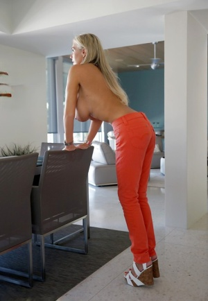 Sassy blonde housewife gets topless and exposes her gorgeous big tits