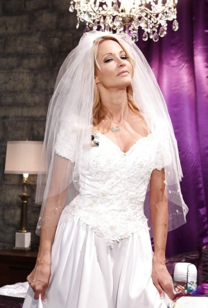Hot MILF in wedding dress Jessica drake undressing and posing with a butt plug