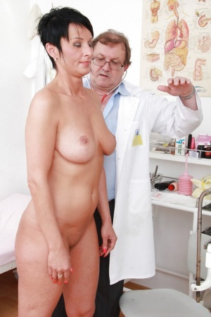 Busty mature brunette gets her pussy examed by a naughty gyno 47737618