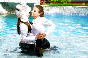 Nikky Thorne has some wet fully clothed pool fun with herfriend