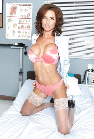 Juggy nurse in white nylon stockings undressing in her office
