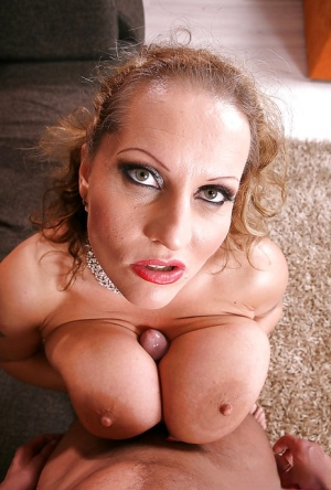 Curvy mature bombshell gets fucked and jizzed over her boobacious tatas