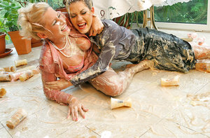 Lusty european fetish vixens hve some messy fully clothed fun